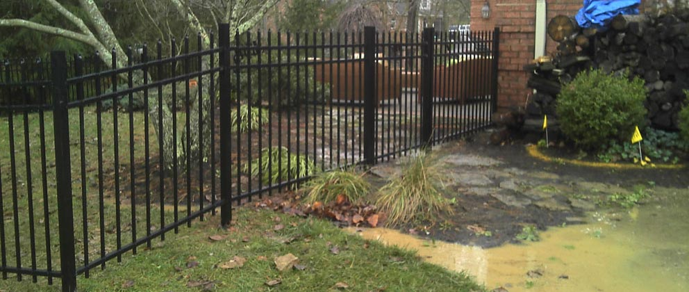 Iron Fence provided by Roark Fencing around a home